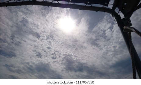 Framed fluffy clouds on a hot sunny day