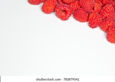 Framed photo of raspberry with copy space on white.