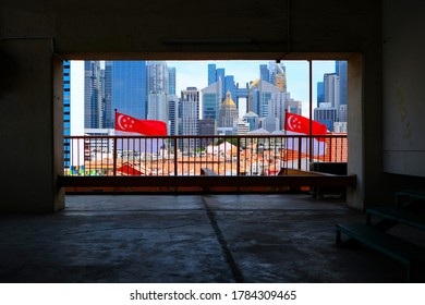 Framed shot of Singapore cityscape on beautiful bright sunny day. Two Singapore flags can be seen waving in the wind