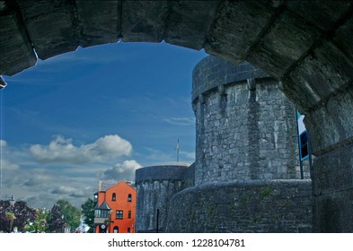 Framed view of ancient stone buildings  of Athlone, Ireland, from under bridge