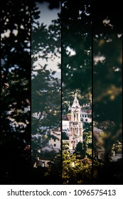 Framed view of a church bell tower through the trees, St. Mark's church, in the island town of Hvar, Croatia. Multi framed vintage filter