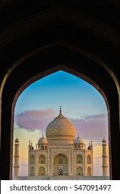 Framed view of the Taj Mahal at sunrise, Agra, India