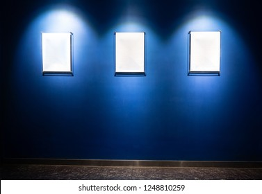 Frames on blue wall