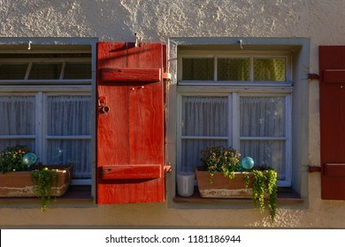 framework facade with red window shutters on a sunny summer morning in south germany city schwaebeisch gmuend