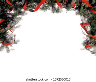 A framework of fir branches, red and gold ribbon, and pine cones isolated on a white background suitable for many uses, including Holiday greeting cards.