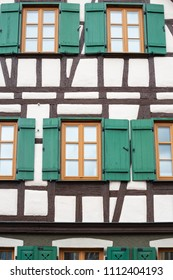 framework historical building facade with green window shutters in imperial city of south germany schwaebisch gmuend