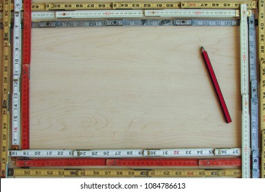 A framework of old vintage folding rulers surrounds open copy space and supports concepts of measurement, metrics, precision, accuracy and results.