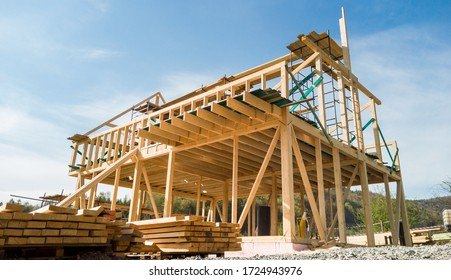Framing of a new wooden house under construction
