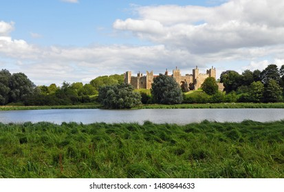 Framlingham, Suffolk, United Kingdom, August 15, 2019. Castle in full sun in the distance shot from across the Mere (lake) and reed beds. Framlingham, Suffolk, United Kingdom, August 15, 2019