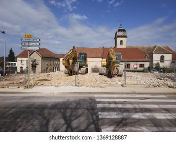 "Saône, France 04/07/2018 : Excavator downtown Saône for deconstruction of ""salle guinemand"""