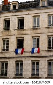 France 2018: Two flags of France Tricolour at Window. World Champion of Soccer