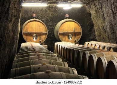 France. Alsace.  Old wine barrels in a wine cellar.