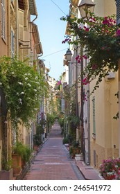 France, Antibes - August 28: Narrow street view in the ancient town ofAntibes on August 28, 2014. Old city of Antibes is a top vacation destination in France.