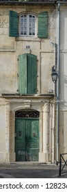 FRANCE ARLES SEP 2018 a door and windows of a building in Arles city of Provence France
