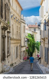 FRANCE ARLES SEP 2018  a view of a street, tourist market and colloseum in Arles city of Provence France