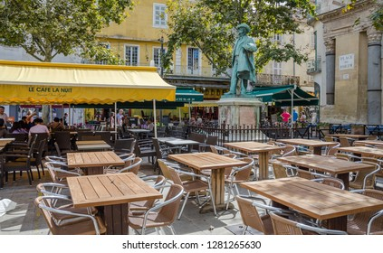 FRANCE ARLES SEP 2018  a view of the exterior of le cafe la nuit (the Night cafe) and the statuse of Van Gogh in Arles city of Provence France