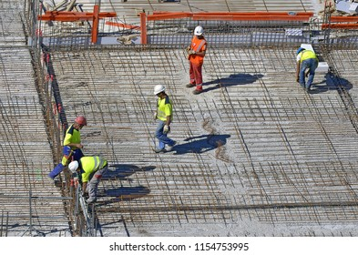 Besançon, France - August 21, 2013: Workers on a construction site.