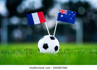 France - Australia, Group C, Saturday, 16. June, Football, National Flags on green grass, white football ball on ground.