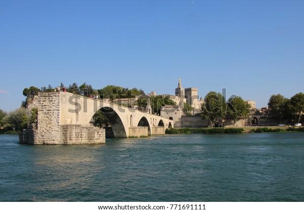 FRANCE, AVIGNON, JULY 31, 2017: Medieval bridge Pont d'Avignon in the town of Avignon, France