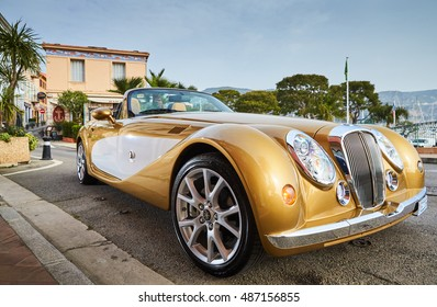 France, Beaulieu, 6 April 2016: Exclusive car, retro type, gold color, standing on embankment and pier in the port, roadster Mitsuoka Himiko, cote dazur, french riviera, Cap Ferrat