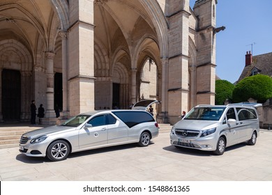 France Beaune 2019-06-19 Image of silver car hearse Mercedes E classe and Mercedes Vito parking on the street near the church. Concept farewell ceremony, last journey, funeral, wake