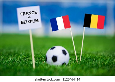 "France and Belgium national Flag on football green grass. White table with tittle ""FRANCE vs. BELGIUM"" France - Belgium, Semifinal. 11. July, Football"