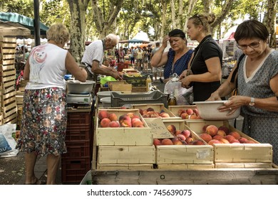 France, Bourgogne Franche Comte, Macon: People residents tourists women in weekly market bustle with sellers, buyers, fruit and vegetables - concept business organic fresh trade. August 05, 2017