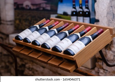 France Burgundy 2019-06-19 store at winery Joseph Drouhin. Wooden rack with famous Pinot Noir red wine. Concept french organic wine production, degustation of grand, premier cru