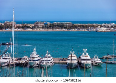 France, Cannes, French Riviera, city skyline and yachts at pier on Mediterranean Sea bay