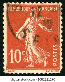 FRANCE - CIRCA 1907: post stamp printed in France shows female sower; woman holding sack and spreading seeds on field; Scott 162 A22 10c red; circa 1907