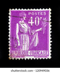 """FRANCE - CIRCA 1933: A stamp printed in France shows a woman with an Olive Branch in hand - allegory of Peace , from the series """"Peace"""", circa 1933"""