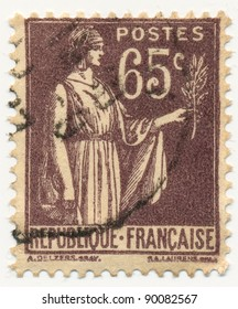 FRANCE - CIRCA 1933: stamp printed by France, shows woman with palm branch, circa 1933