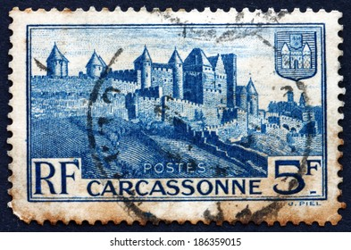 FRANCE - CIRCA 1938: a stamp printed in the France shows Medieval Walls of Carcassonne, Town in the Aude department, in the Former Province of Languedoc, France, circa 1938