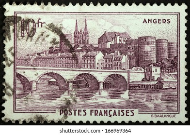 FRANCE - CIRCA 1941: A stamp printed by FRANCE shows view of  Angers town - The Maine river, the Castle, and the spires of the Cathedral, circa 1941.