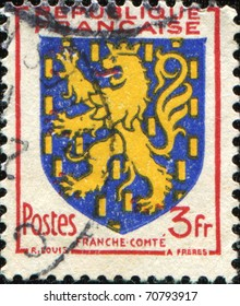 FRANCE - CIRCA 1951: A stamp printed in France shows coat of arms of Franch Comte, circa 1951
