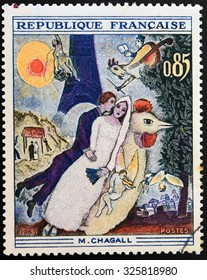 FRANCE - CIRCA 1963: A stamp printed in France shows engraving after painting Married couple at the Eiffel Tower by Marc Chagall, circa 1963