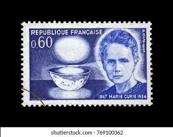 FRANCE - CIRCA 1967: canceled stamp printed in France shows famous polish Nobel prize winner in 1903, 1911 - physicist Marie Sklodowska-Curie (1867-1934), bowl glowing with radium, circa 1967.