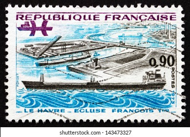 FRANCE - CIRCA 1973: a stamp printed in the France shows Oil Tanker and Francis I Lock, Le Havre, French Technical Achievements, circa 1973