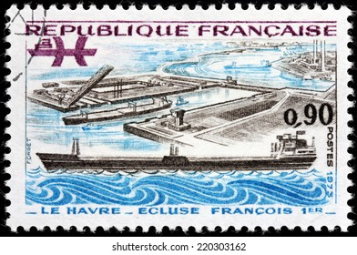 FRANCE - CIRCA 1973: A stamp printed by FRANCE shows view of Oil Tanker and Francis I Lock in Le Havre, the Seine-Maritime department, the Haute-Normandie region, France, circa 1973