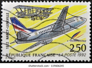 FRANCE - CIRCA 1992: A postage stamp printed in France shows the plane that made the first trip zip between Nancy and Luneville in 1912, circa 1992.