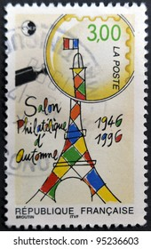 FRANCE - CIRCA 1996: A stamp printed in France shows drawing of the eiffel tower view behind the lens, circa 1996