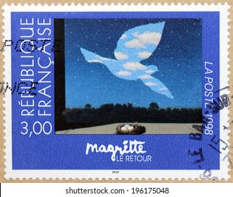 FRANCE - CIRCA 1998: A stamp printed by FRANCE shows painting The Return (Le Retour) by famous Belgian surrealist artist Rene Magritte (1898-1967), circa 1998