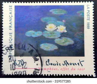 FRANCE - CIRCA 1999: A postage stamp printed in France showing an image of a work by the painter Claude Monet entitled  Water Lilies, Evening Effect, circa 1999.