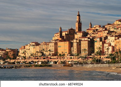 France Cote D'Azur French Riviera Menton Panoramic view of old town and beach at dusk