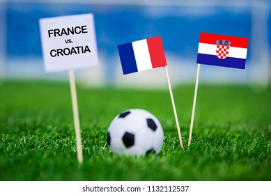 """FRANCE and CROATIA national Flag on football green grass. White table with tittle """"FRANCE vs. CROATIA"""""""