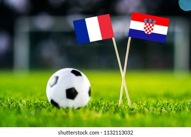 FRANCE and CROATIA national Flag on football green grass. France - Croatia, FINAL OF World Cup, Russia 2018