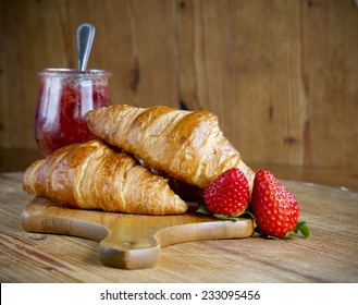 France croissant with  fruit on ten wood background
