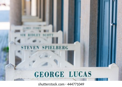 FRANCE, DEAUVILLE - SEPTEMBER 27: original beach closets with famous names on promenade Des Planches in Deauville, France on September 27, 2015