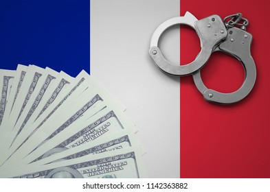 France flag  with handcuffs and a bundle of dollars. The concept of illegal banking operations in US currency