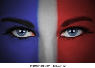 France flag painted on the face of a woman